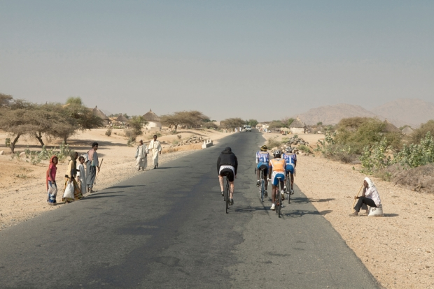 Patrick Seabase in Eritrea will local riders. Photo by Yuhzimi Ltd and Ian G. C. White.
