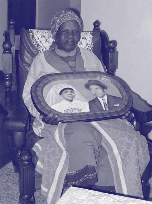 Senyane Boshielo holding her wedding portrait, produced by Alpheus Gwangwa studio in Alexandra during 1970s. Family collection, Limpopo.