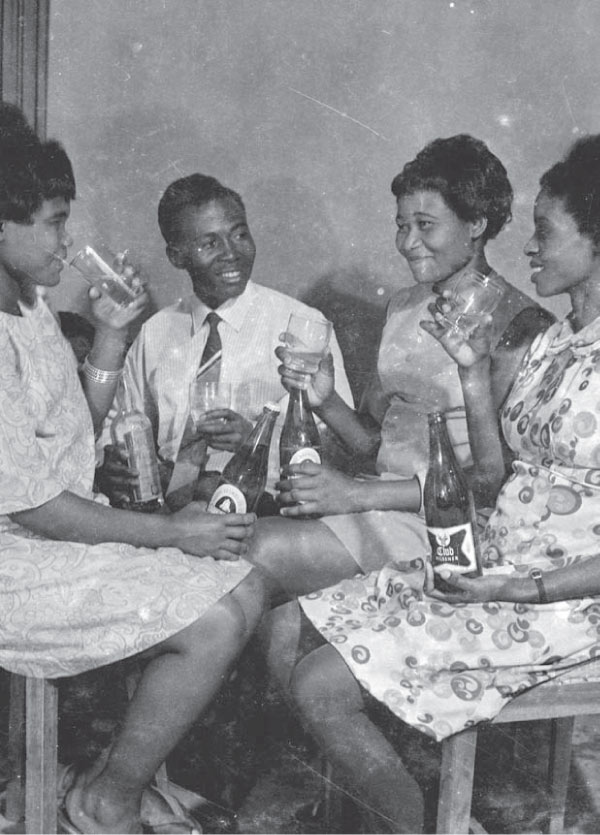 Deo Kyakulagira (second left),  with his wife Eva on the far left in their studio.