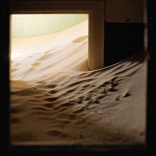 Deep sand inside a house in Kolmanskop.