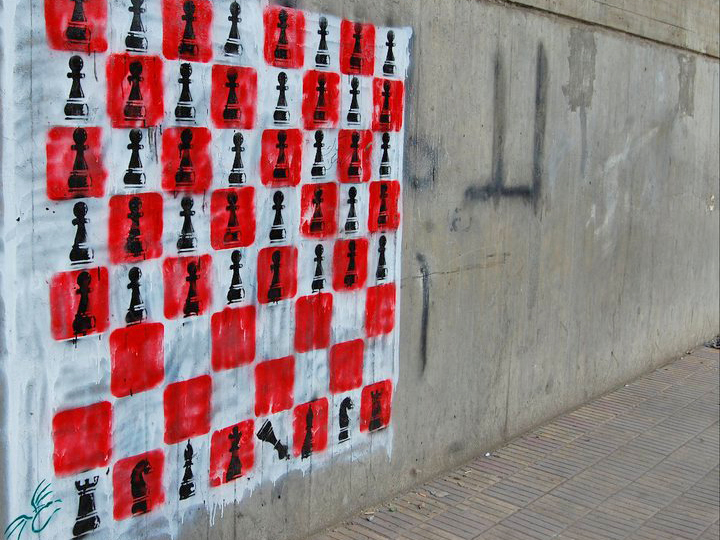 Check Mate. The King is toppled over by an army of pawns. Cairo, Egypt, 2011. Tagged by El Teneen.