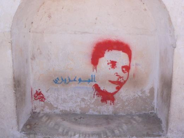 Portrait of vegetable vendor, Mohamed Bouazizi who committed self-immolation, December 2010 in front of Sidi Bouzid's regional government building. Tagged by Unknown. Tunisia, 2011.