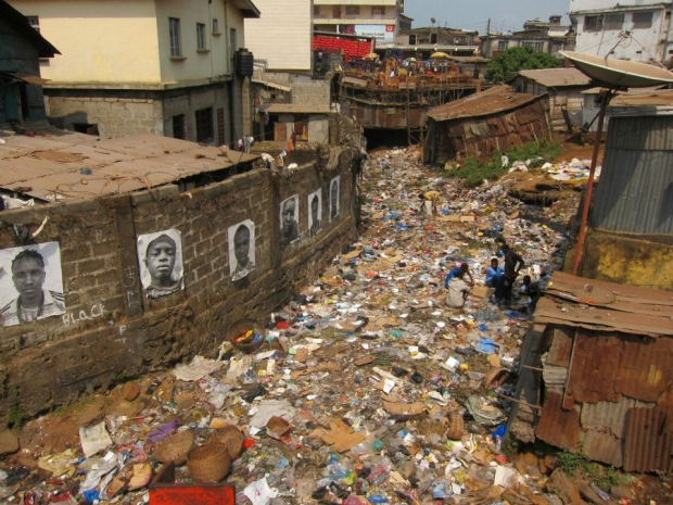 """Inside Out"" project by French street artist JR featuring portraits of the Lion Base crew hung in the slums of Freetown, Sierra Leone."