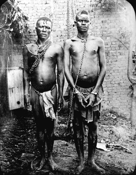 Alice Seeley Harris, Manacled members of a chain gang at Bauliri. A common punishment for not paying taxes, Congo Free State, c. 1904. Courtesy Anti-Slavery International / Autograph ABP.