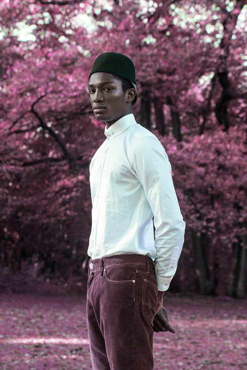Photo © Mehdi Sefrioui. Josué Comoe wearing shirt by Ted Baker, pants by US Polo and hat by Marks & Spencer.