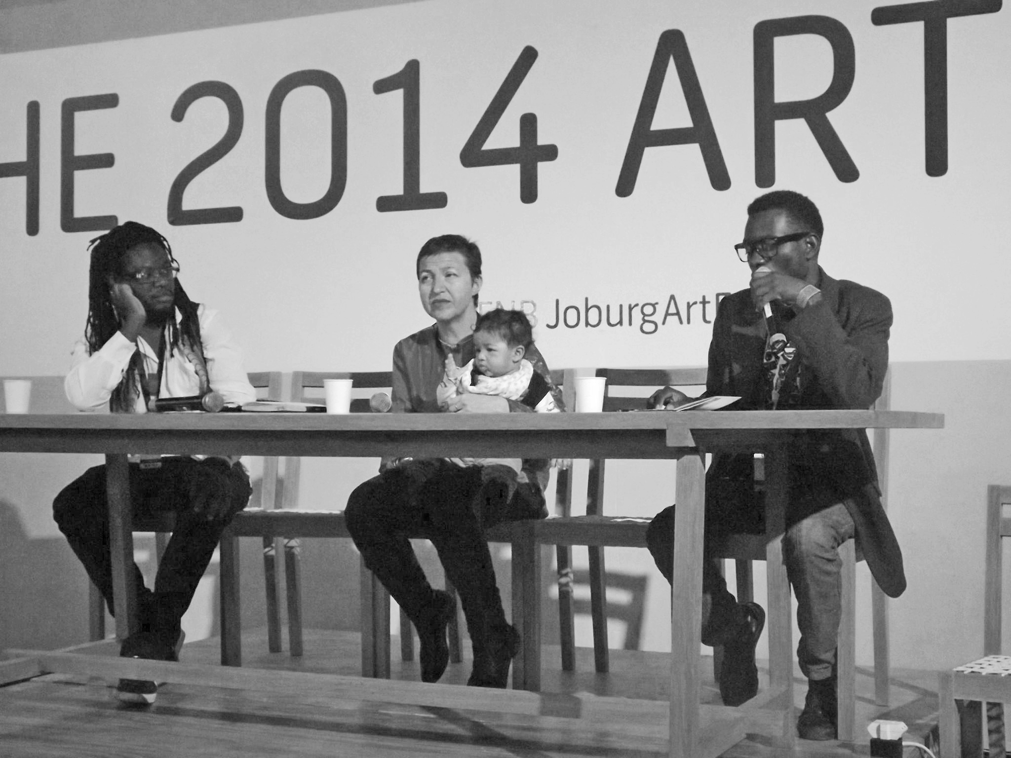 Marcus Gora and Valerie Kabov (founders of First Floor Gallery), and artist Moffat Takadiwa at FNB Joburg Art Fair, 2014 presenting New Models for Art Organisations in Africa-First Floor Gallery Harare: A Case Study.