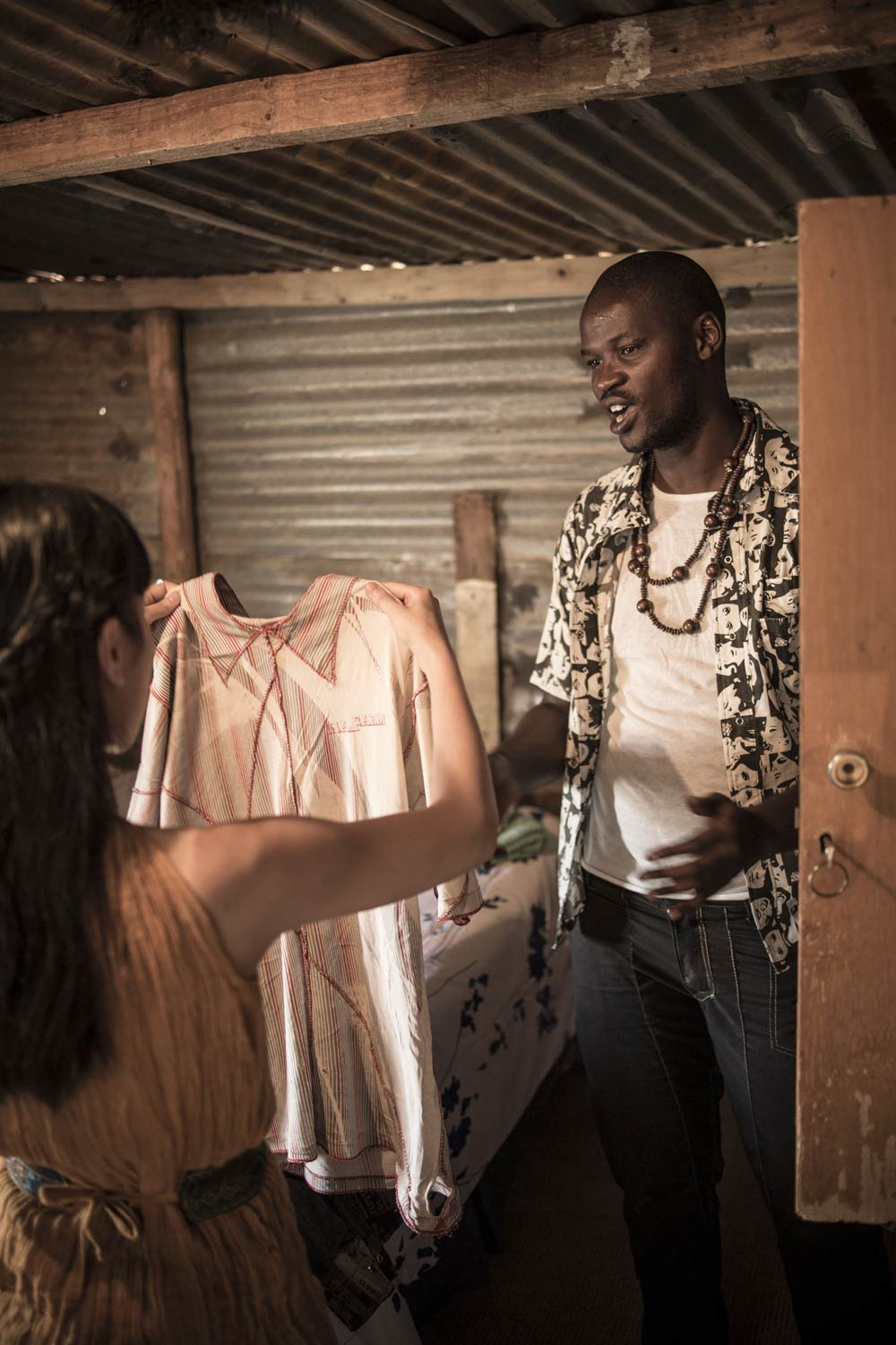 Jenny and Macdee discussing  their past designs and sharing ideas at his home in Orange Farm township. Photo by Chris Saunders.