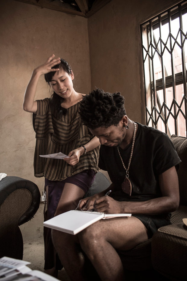 Discussing design ideas with designer and hat maker Floyd Avenue. Photo by Chris Saunders.