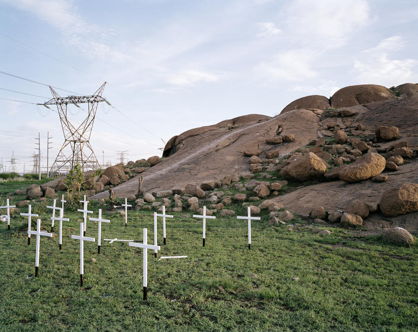 © Ilan Godfrey. Thirty-four white wooden crosses symbolise the slaying of the Lonmin miners at the Koppies in Marikana by the South African police on 16 August 2012. From Legacy of the Mine, 2011–2013.