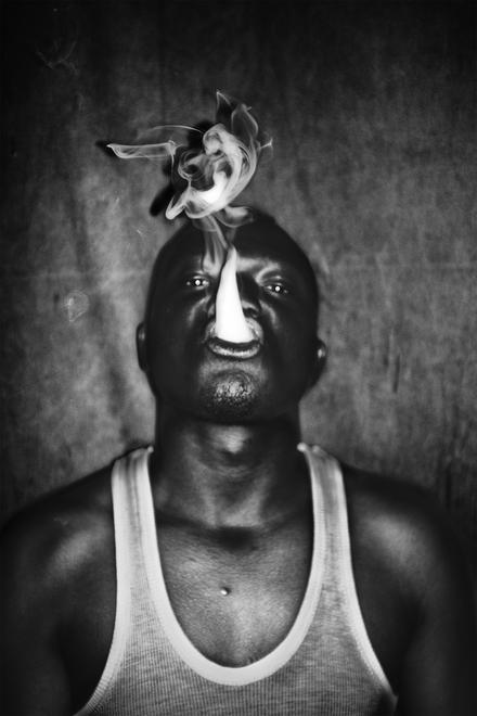 ©Léonard Pongo. 9A, a local rapper, posing after a concert the French Institute. From The Uncanny, 2013.