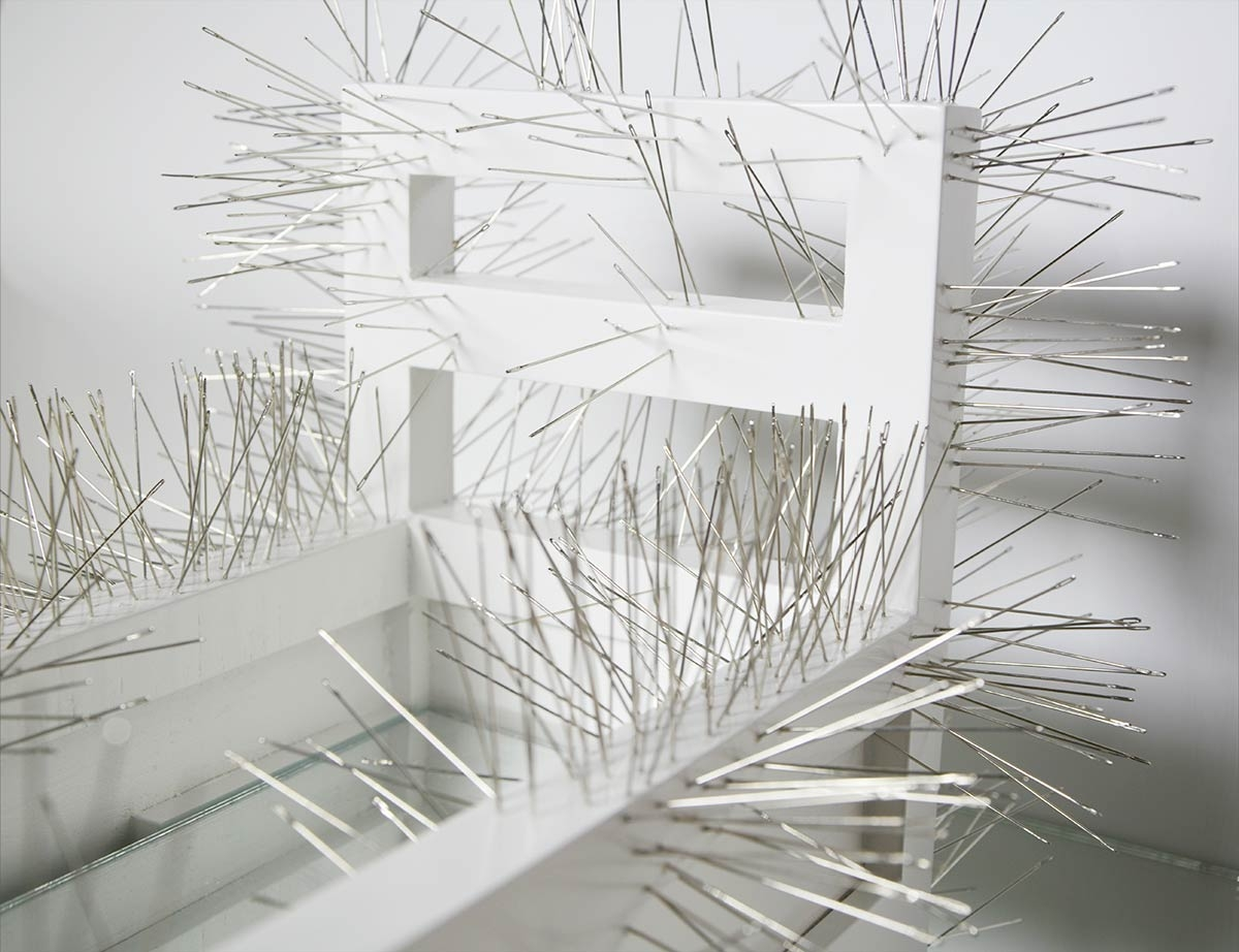 Safâa Erruas, detail from Inaccessible, 2014. Sculpture, wooden bed, needles and mirror under a plexiglas dome, 40 x 40 cm. Courtesy the artist and L'atelier 21, Casablanca