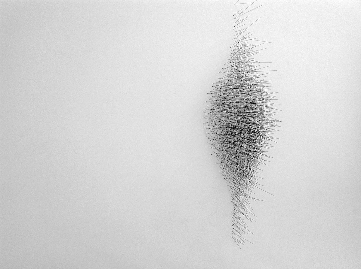 Safâa Erruas, Untitled, 2012. Installation with piano strings on wall, 130 cm height. Courtesy the artist and Dominique Fiat, Paris