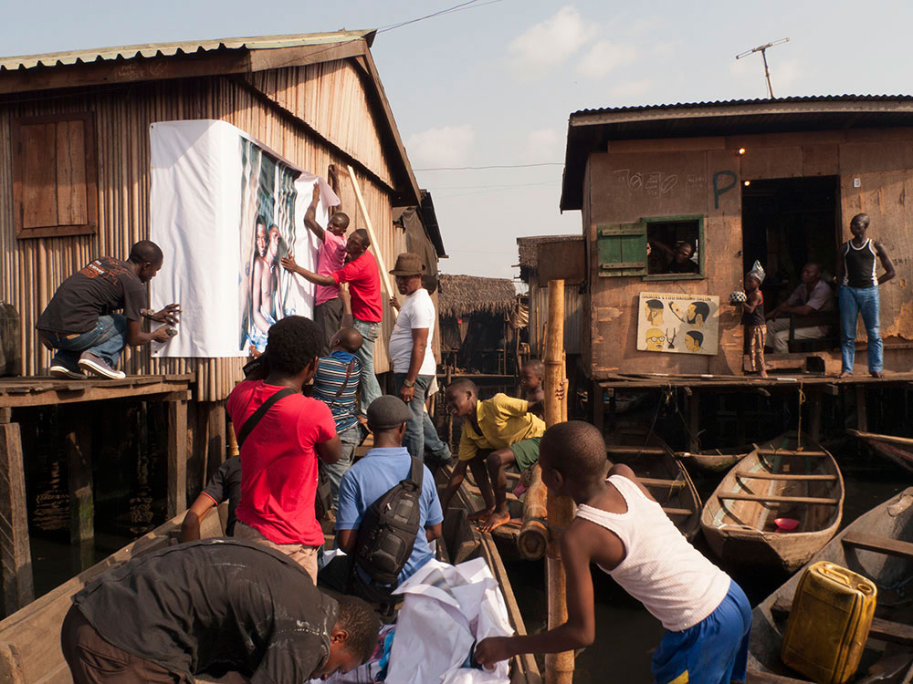 Installing the exhibition, The Silent Project in Makoko.