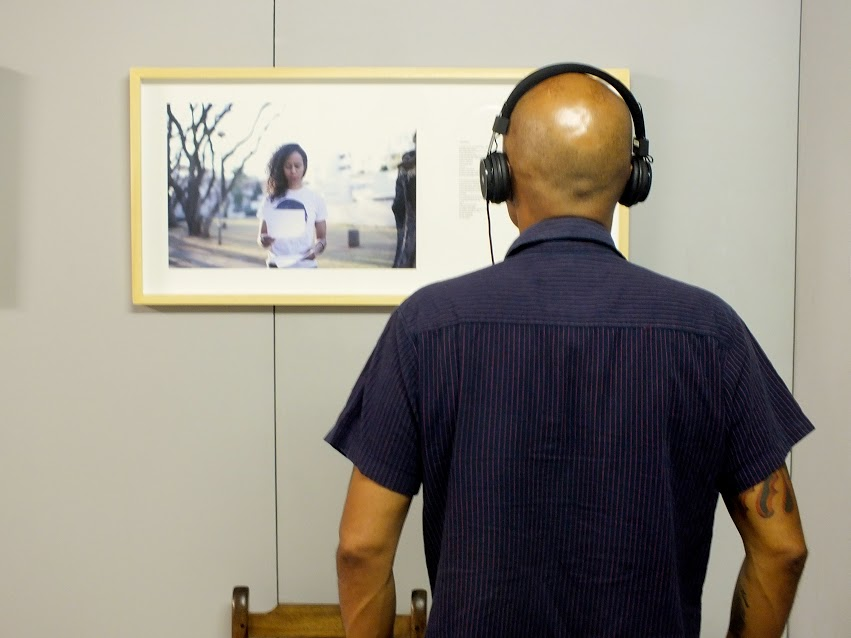 Viewer engages with sound installation of Erin Bosenberg.  Photo | Nicola van Straaten / Another Africa.