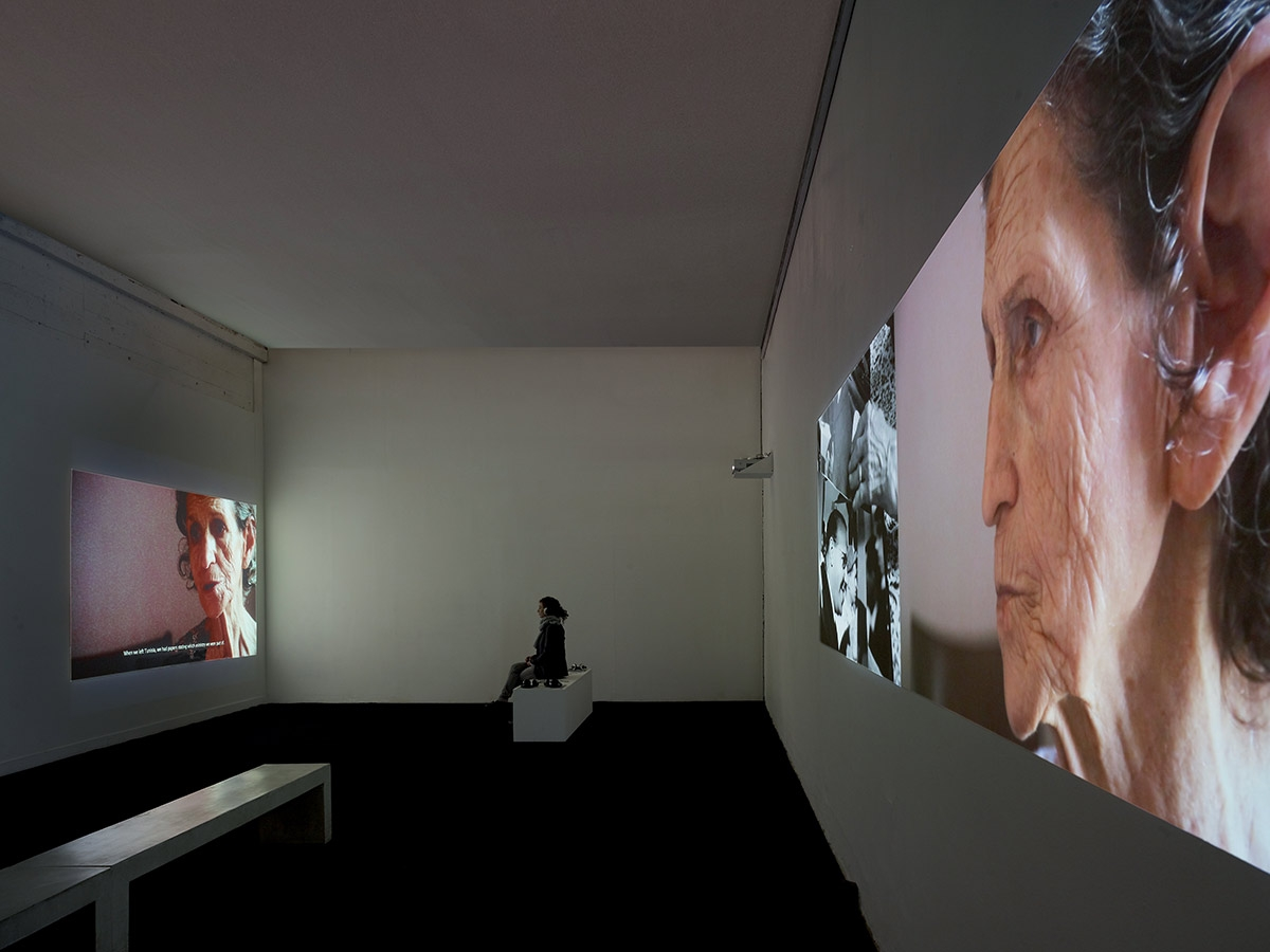 "Zineb Sedira, Gardiennes d'images (Image Keepers), 2010. Three screens video projections with sound. Exhibition view: ""Gardiennes d'images"", Palais de Tokyo, Paris, 2010. © Photo: André Morin. Courtesy the artist and kamel mennour, Paris"